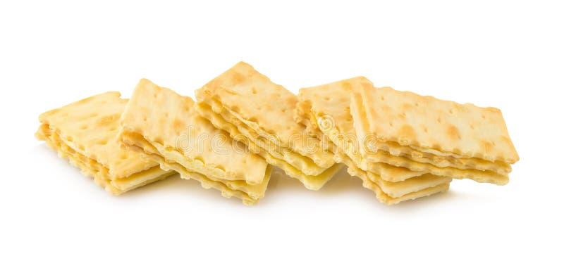 Cracker met romige die laag op witte achtergrond wordt geïsoleerd royalty-vrije stock foto's