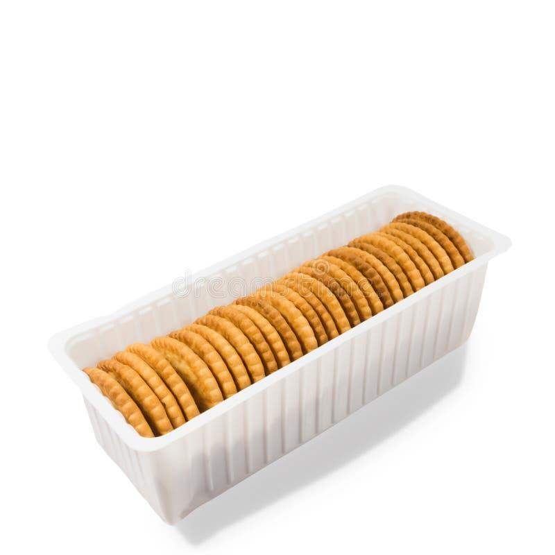 Crackerkoekjes op witte achtergrond worden geïsoleerd die stock afbeelding