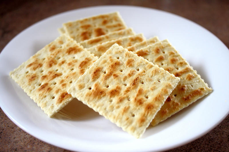 Crackers. Crisp saltine crackers on a plate. A great low fat snack or as an accompaniment with soups royalty free stock photography
