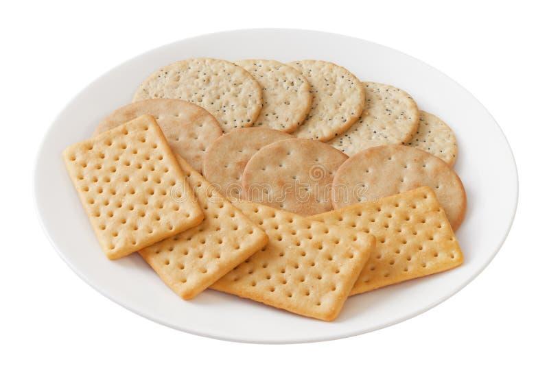 Crackers op een plaat stock foto's
