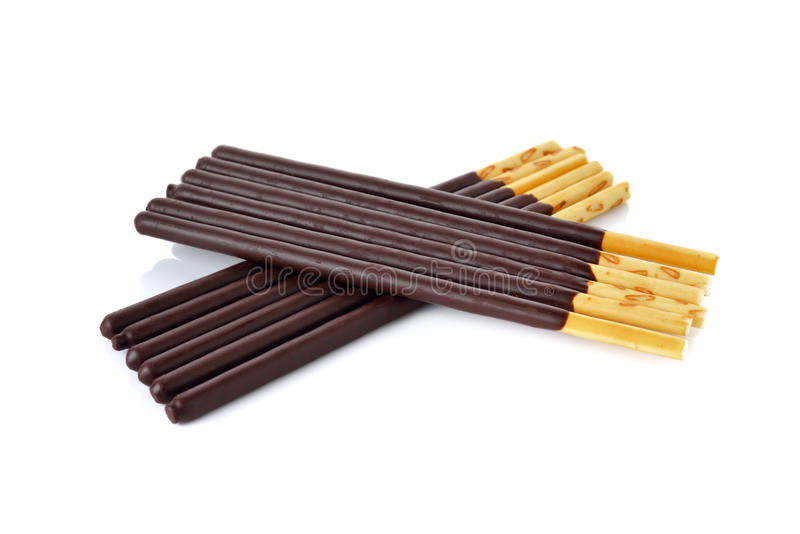 Crackers stick and coated with black chocolate on white royalty free stock images