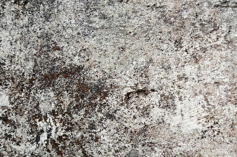 Cracking and peeling paint on a old wall. background texture. grunge background. royalty free illustration