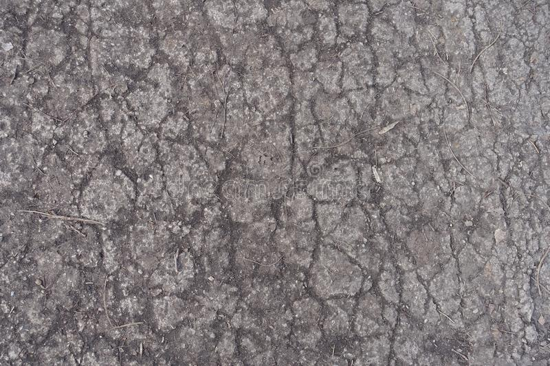 Crackled surface of old concrete road stock images