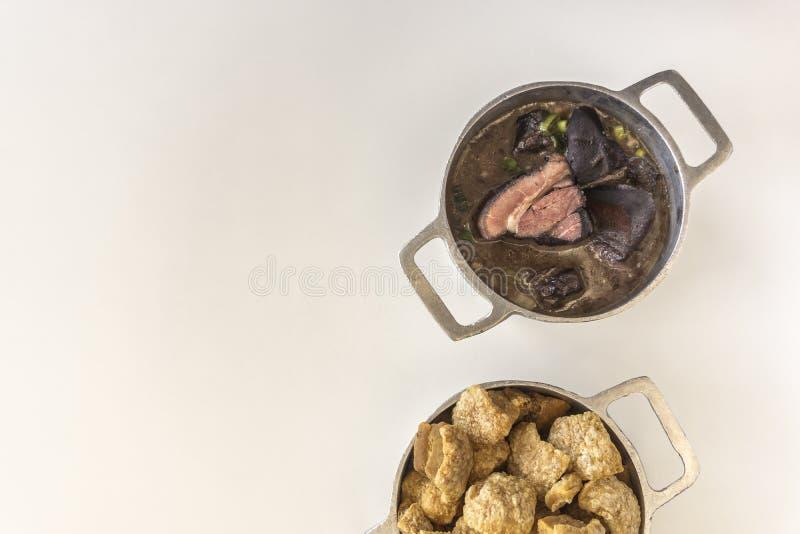 Crackling accompanies the feijoada, Brazilian typical dish royalty free stock photo