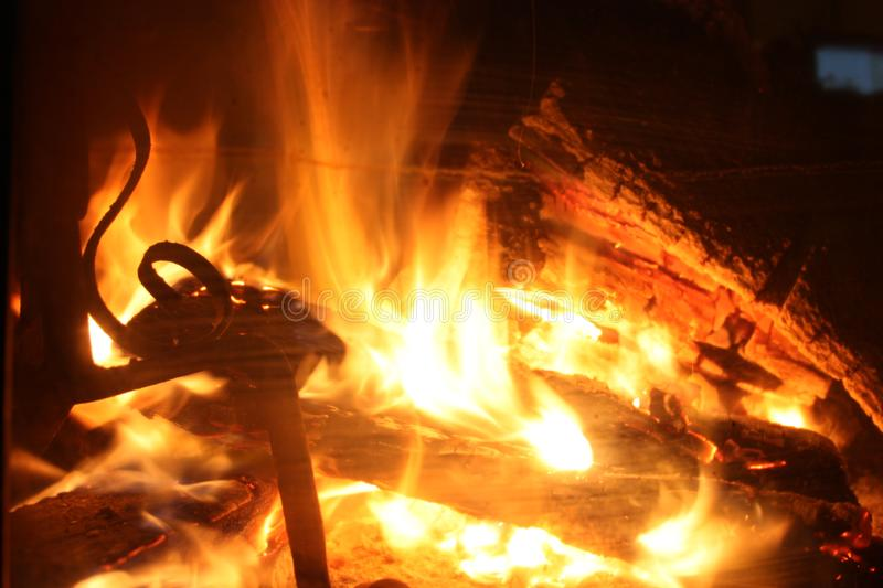 The crackling fire of a lit fireplace that recalls the winter Christmas atmosphere stock images