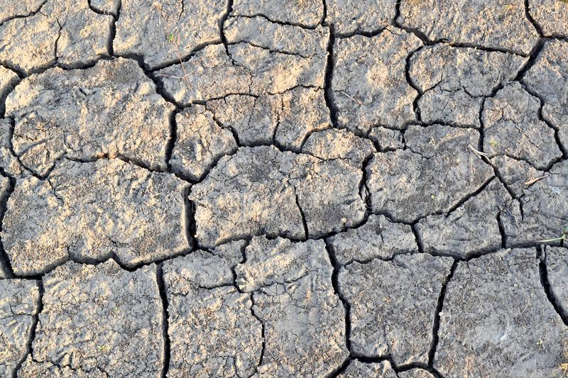 Cracks in the ground. Dry, dehydrated soil. Drought. Ecological catastrophy stock images