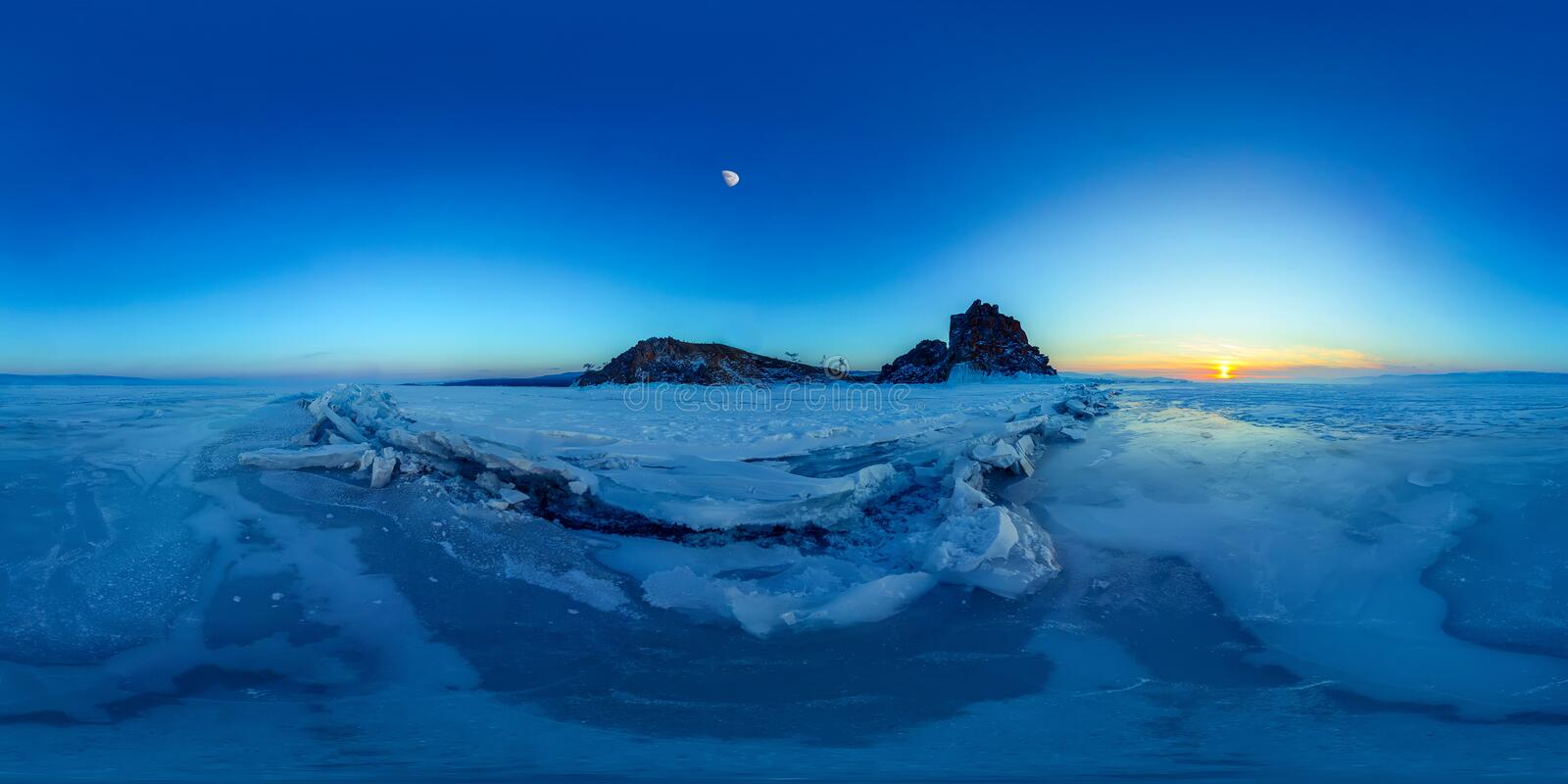 Big cracks in the ice of Lake Baikal at the Shaman Rock on Olkhon Island. Spherical 360 degree vr panorama. Cracks in the ice of Lake Baikal at the Shaman Rock stock photography