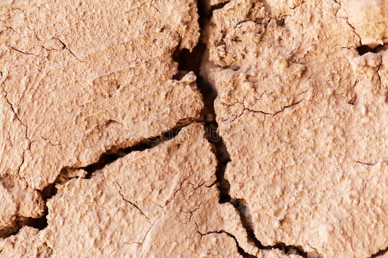 Cracks in old mud mortar. stock photos