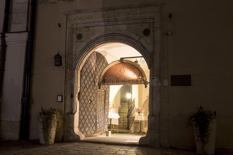 Cracow, Kanonicza Street by night, gate to one restaurant royalty free stock photo