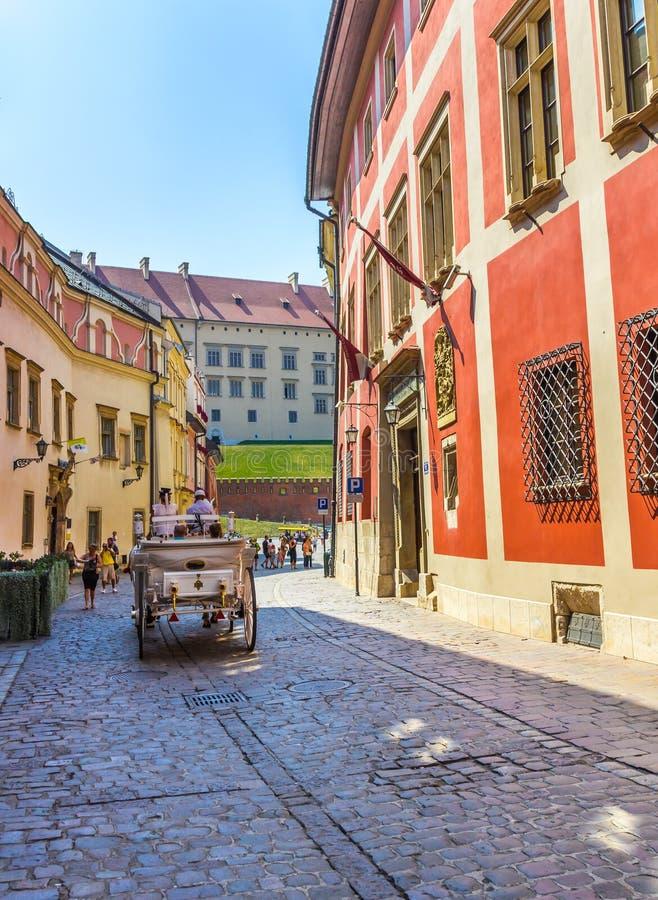 Cracow (Krakow)-Poland- horse carriage tour. Horse-drawn carriage tour- beautiful Kanonicza Street-old town- Krakow (Cracow), Poland royalty free stock photography