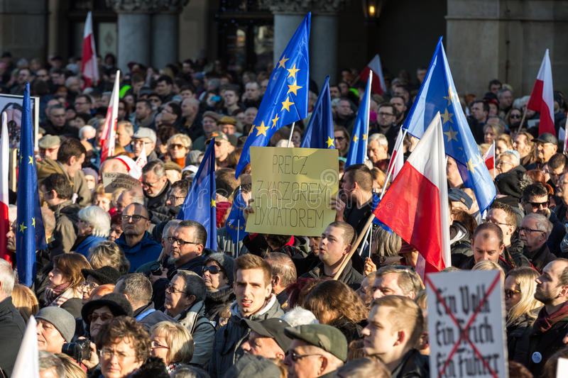 Cracow, Main Square - The demonstration of the Committee of the Protection of Democracy. CRACOW, POLAND - DECEMBER 19, 2015: Cracow, Main Square - The stock photo