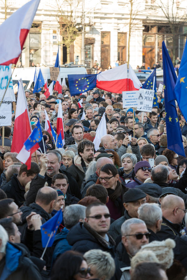 Cracow, Main Square - The demonstration of the Committee of the Protection of Democracy. CRACOW, POLAND - DECEMBER 19, 2015: Cracow, Main Square - The royalty free stock photography