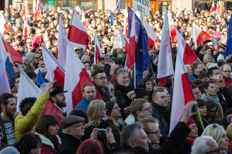 Cracow, Main Square - The demonstration of the Committee of the Protection of Democracy. CRACOW, POLAND - DECEMBER 19, 2015: Cracow, Main Square - The stock photos