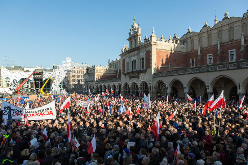 Cracow, Main Square - The demonstration of the Committee of the Protection of Democracy. CRACOW, POLAND - DECEMBER 19, 2015: Cracow, Main Square - The royalty free stock photo
