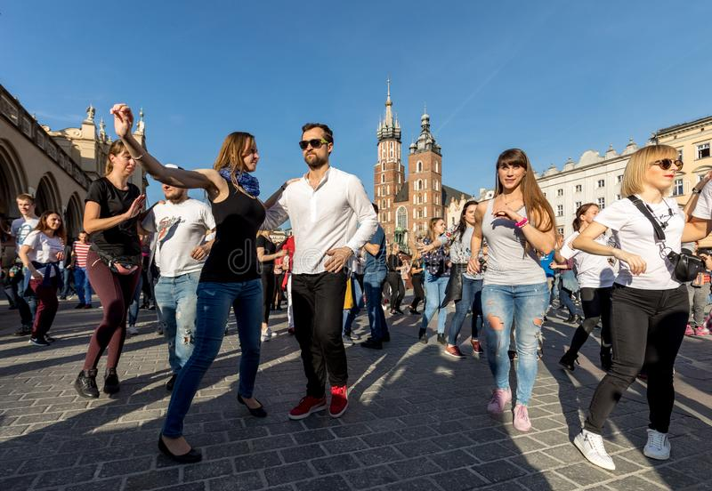 International Flashmob Day of Rueda de Casino. Several hundred persons dance Hispanic rhythms on the Main Square in Cracow. royalty free stock images