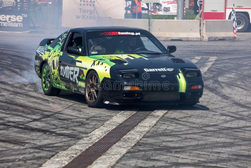 Drift car in action  at 5th edition of Moto Show in Cracow. Poland. Cracow, Poland - May 18, 2019: Drift car in action  at 5th edition of Moto Show in Cracow royalty free stock photography