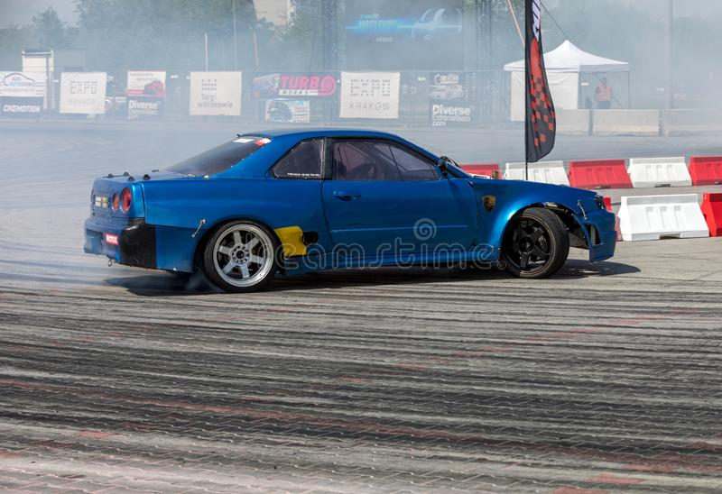 Drift car in action  at 5th edition of Moto Show in Cracow. Poland. Cracow, Poland - May 18, 2019: Drift car in action  at 5th edition of Moto Show in Cracow stock photos