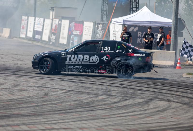 Drift car in action  at 5th edition of Moto Show in Cracow. Poland. Cracow, Poland - May 18, 2019: Drift car in action  at 5th edition of Moto Show in Cracow royalty free stock photo