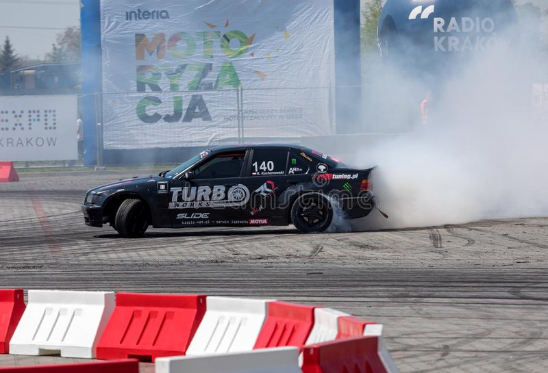 Drift car in action  at 5th edition of Moto Show in Cracow. Poland. Cracow, Poland - May 18, 2019: Drift car in action  at 5th edition of Moto Show in Cracow royalty free stock image