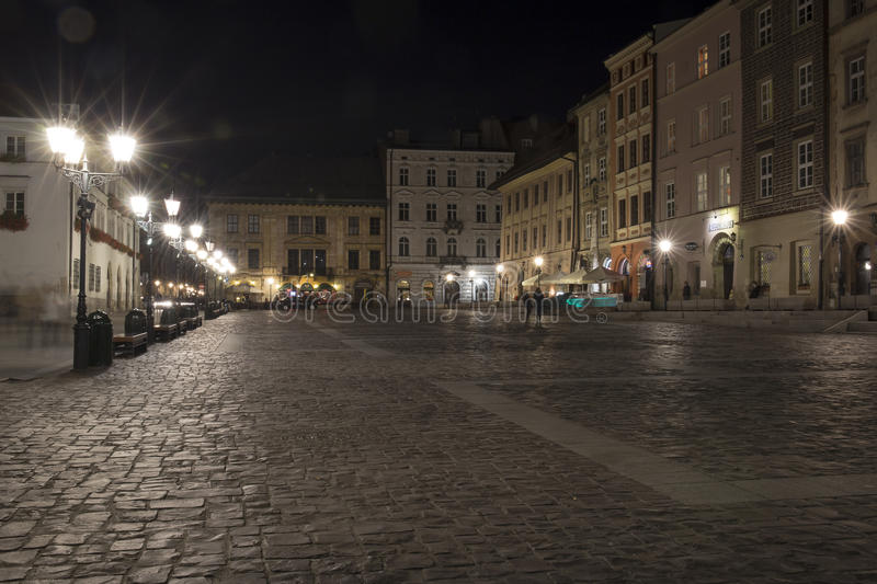 Cracow, The Small Market Square by night royalty free stock image