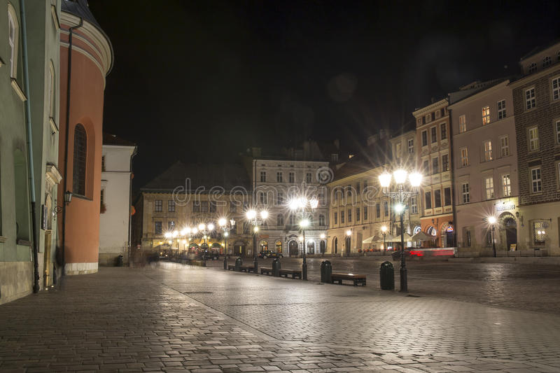 Cracow, The Small Market Square by night royalty free stock photos