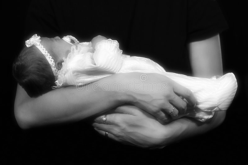 Cradle. A newborn baby girl, cradled in her mommy's arms