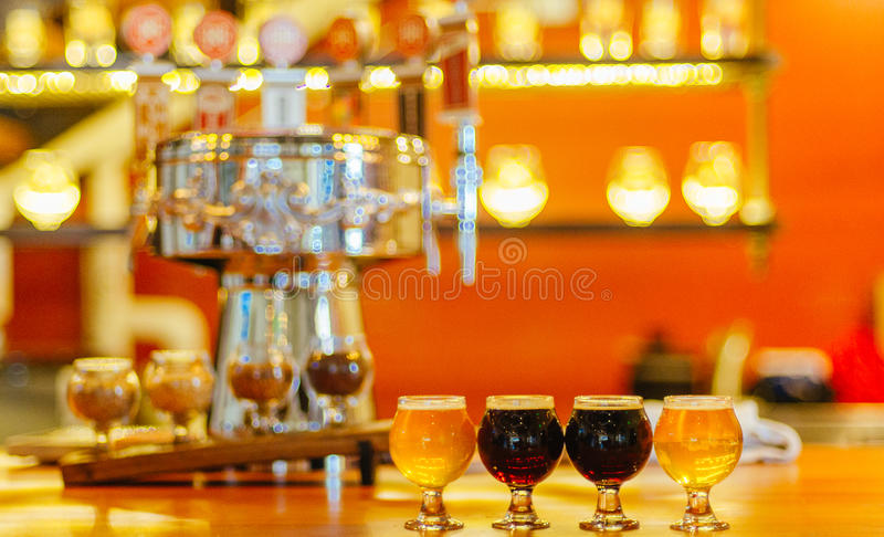 Craft beer flight at the bar royalty free stock images
