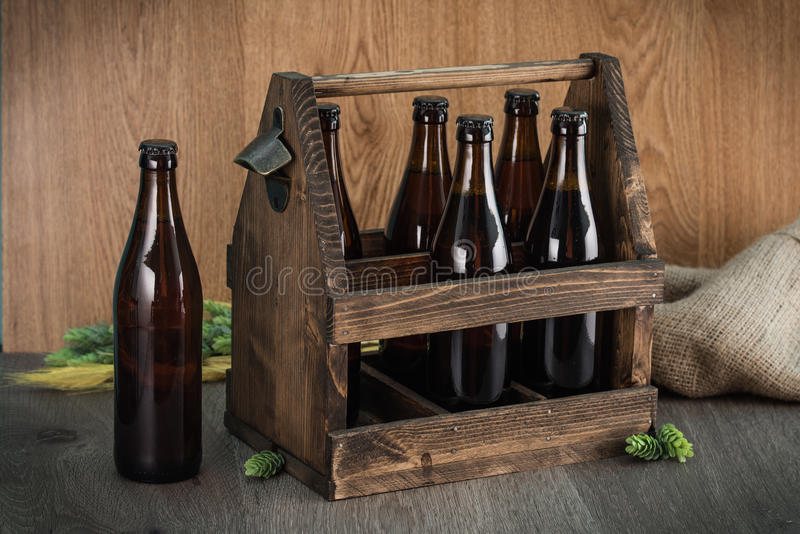 Craft beer from a wooden box. royalty free stock photo
