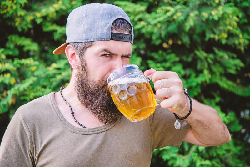 Craft beer is young, urban and fashionable. Beer and ale concept. Man relaxing enjoying beer hot summer day. Quench. Thirst. Alcohol drink and bar. Hipster royalty free stock photography