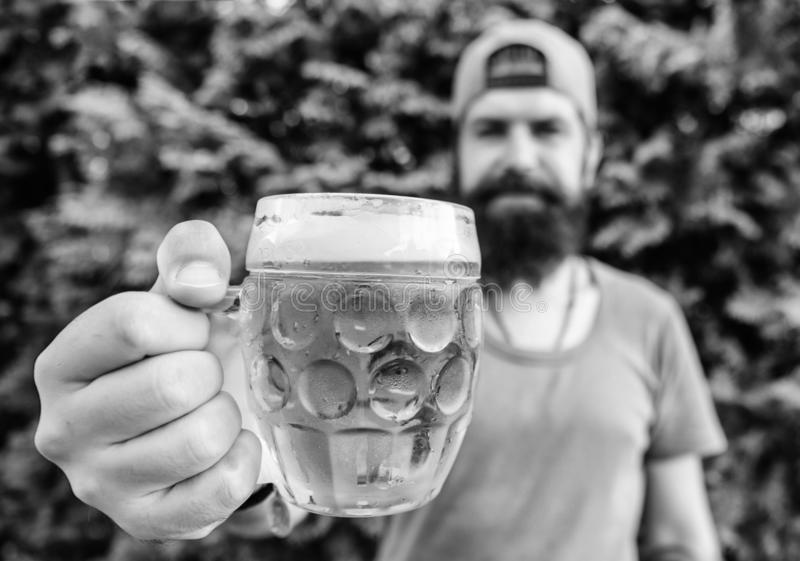 Craft beer is young, urban and fashionable. Creative young brewer. Distinct beer culture. Hipster brutal bearded man. Hold mug cold fresh beer. Man enjoying royalty free stock images