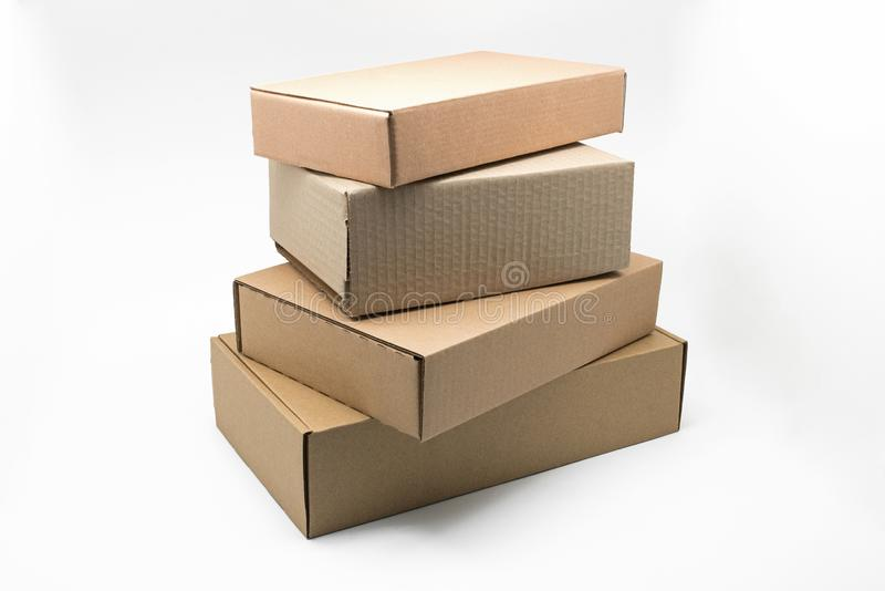 Stacked boxes of brown cardboard on a white background, recyclable material. Respects the environment stock photos