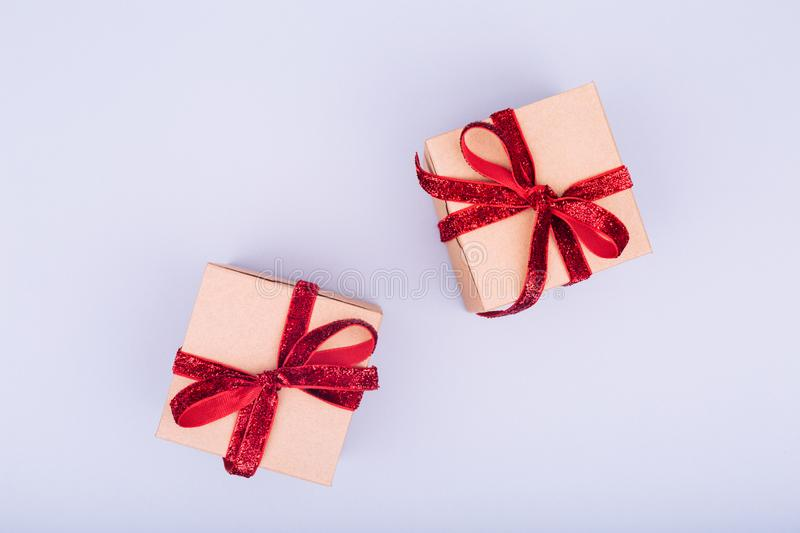 Craft box with red ribbon bow. Valentine day concept. Trendy min stock images