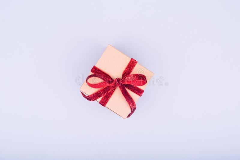 Craft box with red ribbon bow. Valentine day concept. Trendy min stock photos