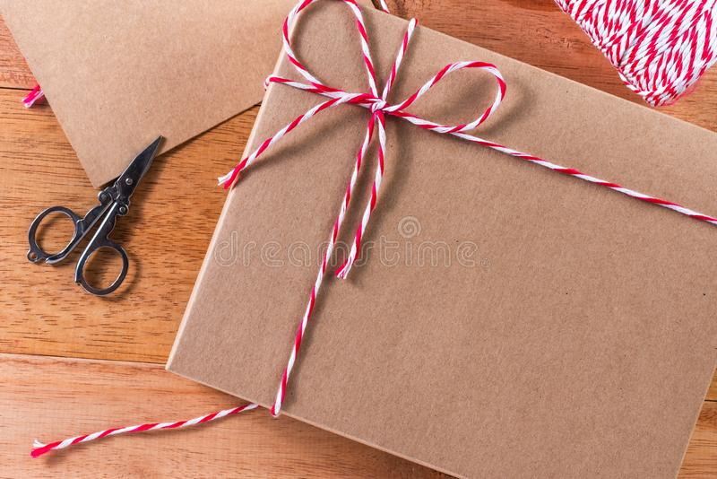 Craft box tied with red and white rope royalty free stock image