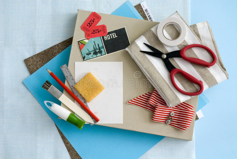 Craft and card stationary supplies. Various stationary and craft supplies on light blue background stock photo