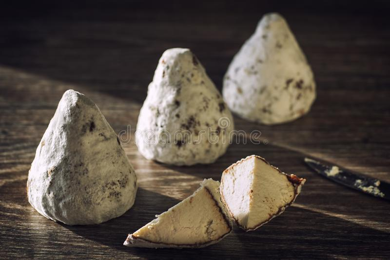 Craft cheese from cows and goats milk. Cheese head stock images