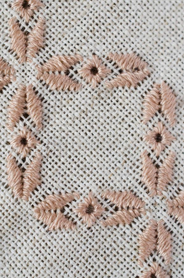 Craft embroidery by brown and beige threads. stock images
