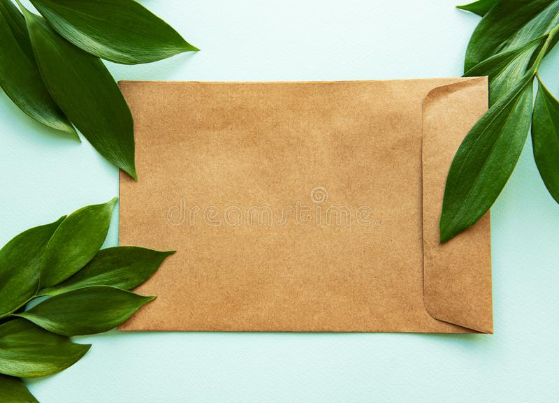 Craft envelope and green leaves stock photography