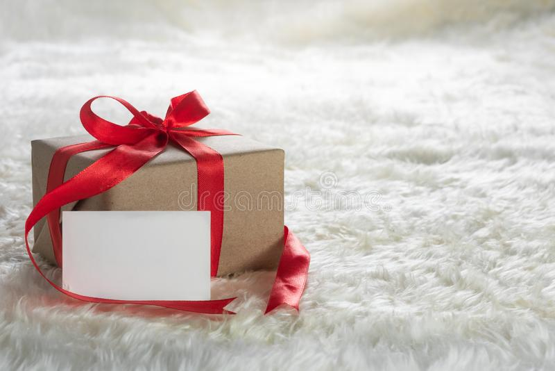 Gift box and card on wool royalty free stock photos