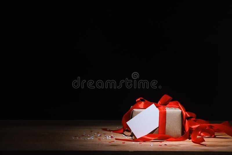 Gift box and white card royalty free stock photo
