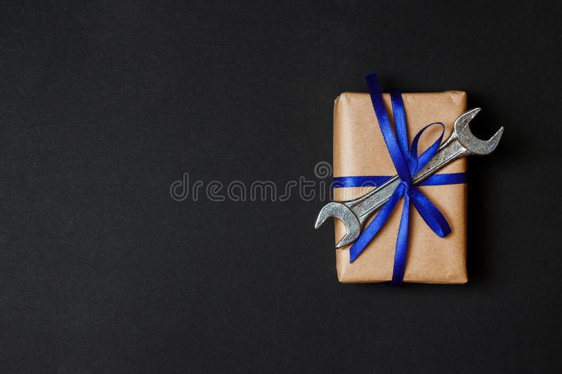 Craft gift with old tool on black paper background. Fathers day concept. Flat lay stock photography