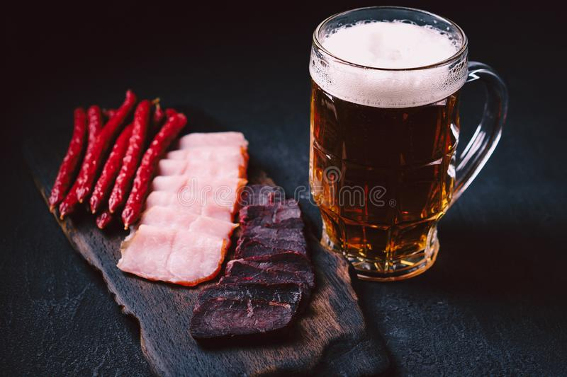 Craft lager beer and meat snacks set. bar table royalty free stock images