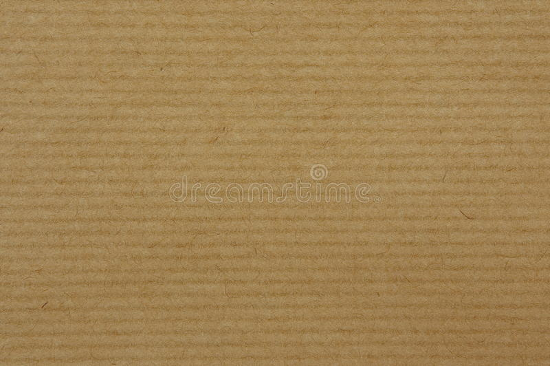 Craft paper background - RAW file. Texture of striped brown craft paper for backgrounds or templates royalty free stock photography