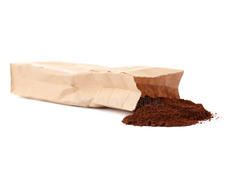 Craft paper pack full of ground coffee isolated over white background. Craft brown paper pack full of ground coffee isolated over white background royalty free stock photo