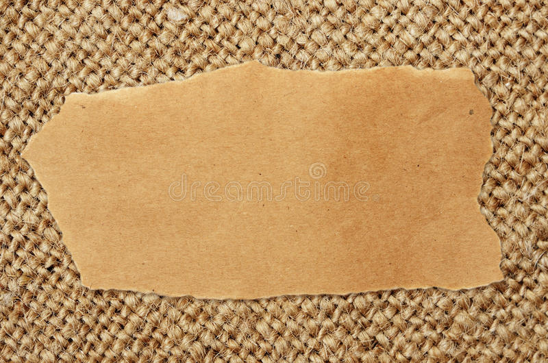 Craft paper sheet on canvas. Background stock images
