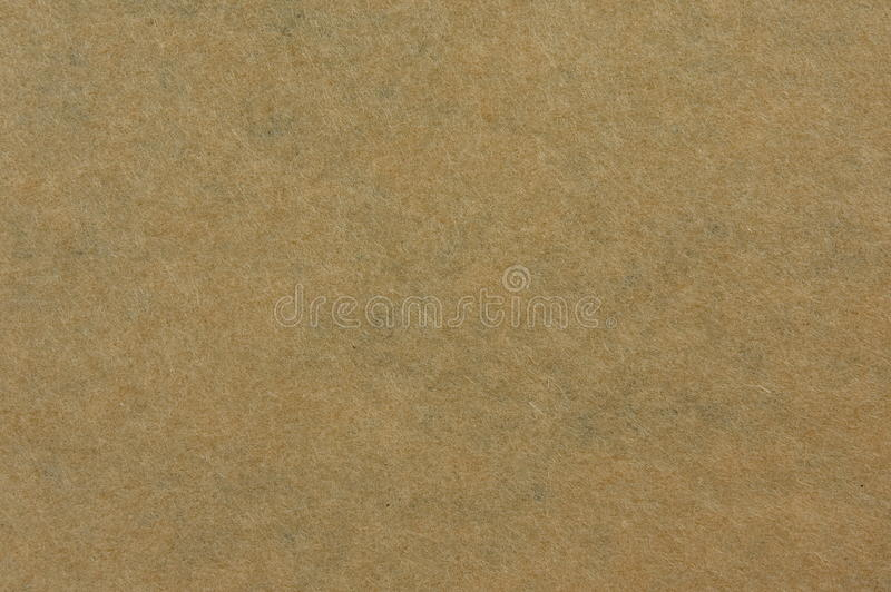 Craft paper texture - RAW file. Texture of brown craft paper to be used as backgrounds or templates royalty free stock photo