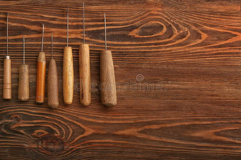 Craft tools for work with leather on wooden table stock photos