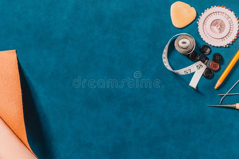 Crafting tools on natural leather on background. Frame with sewing tools and accessories. Top view stock image