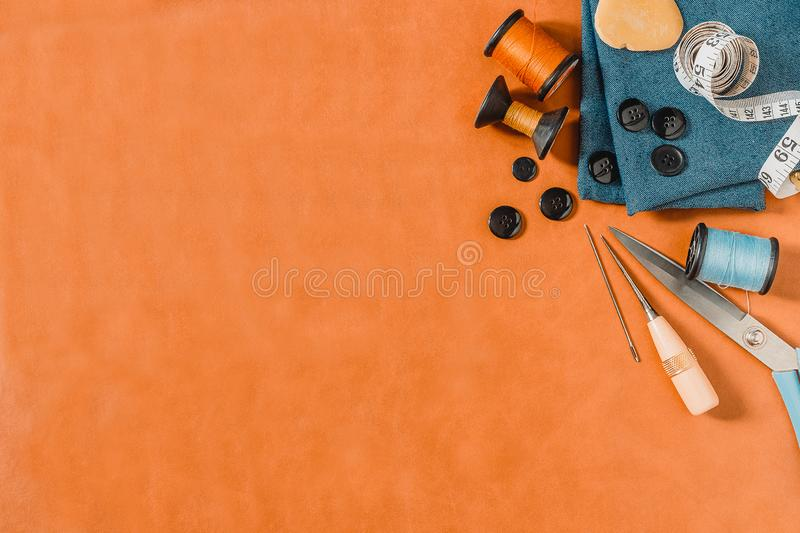 Crafting tools on natural leather on background. Frame with sewing tools and accessories.Top view stock photography