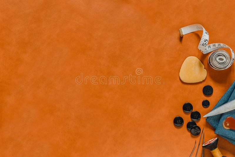Crafting tools on natural leather on background. Frame with sewing tools and accessories. Top view stock images